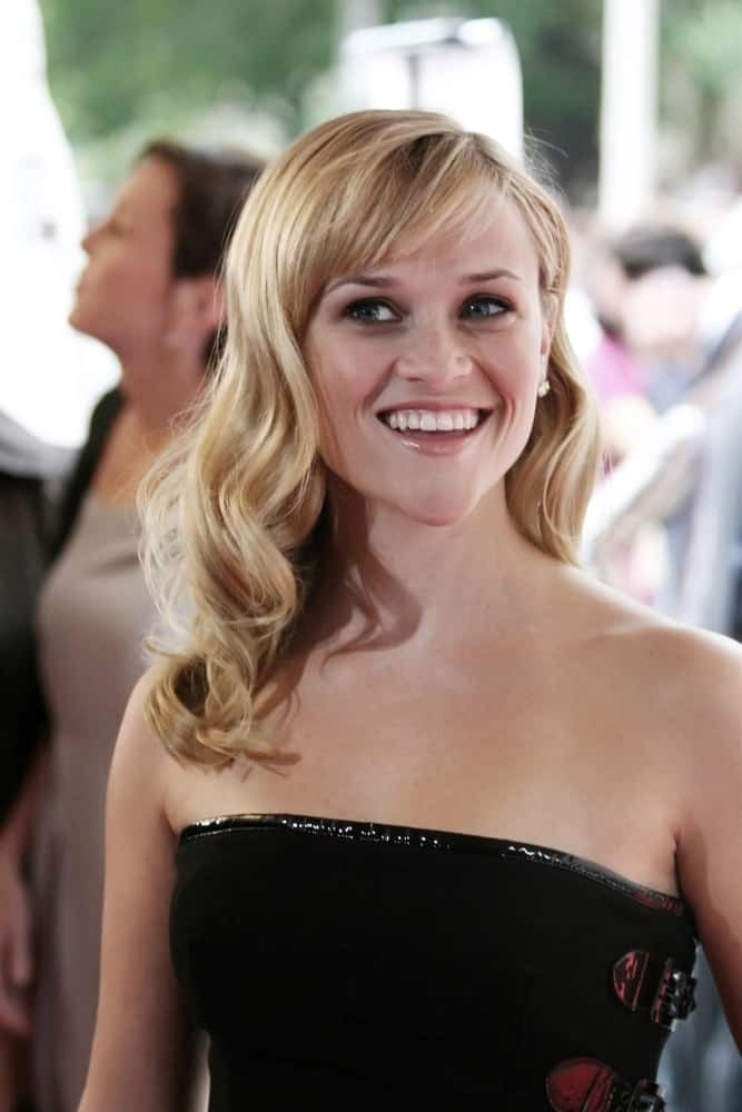 Reese Witherspoon's black strapless dress paired quite perfectly with her long side-swept blond hairstyle with elegant curls and short bangs at the RENDITION World Premiere in Roy Thomson Hall, Toronto, Canada, ON on September 07, 2007.