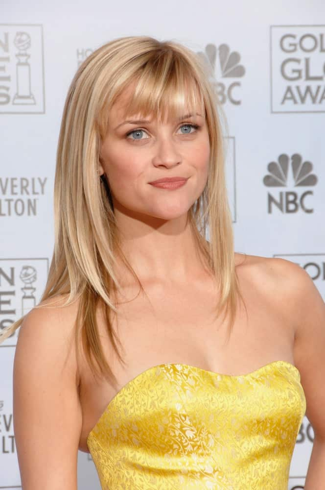 The lovely Reese Witherspoon wore a strapless yellow dress that paired quite well with her loose and straight blond hairstyle that has bangs at the 64th Annual Golden Globe Awards at the Beverly Hilton Hotel on January 15, 2007 in Beverly Hills, CA.