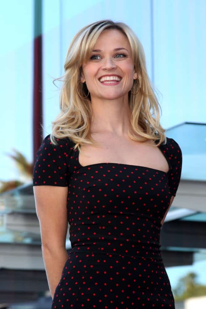 Reese Witherspoon was brimming with pride at her Hollywood Walk of Fame Star Ceremony at the W Hotel Hollywood on December 1, 2010 in Los Angeles, CA. She wore a polka dotted black dress that she paired with her layered and tousled blond hair with bangs.