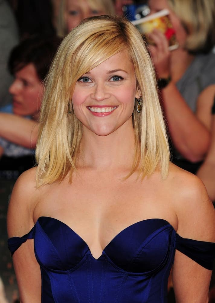 Reese Witherspoon was quite charming in her blue off-shoulder dress and shoulder-length tousled blond bob hairstyle with side-swept bangs at the UK Premiere of Water For Elephants in Westfield, London on May 3, 2011.