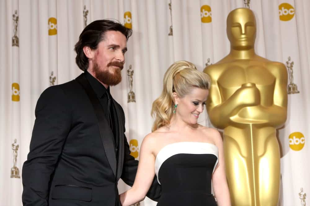 Christian Bale and Reese Witherspoon were at the 83rd Academy Awards at Kodak Theater, Hollywood & Highland on February 27, 2011 in Los Angeles, CA. Witherspoon wore an elegant black dress that she paired with a flowing and wavy ponytail hairstyle.