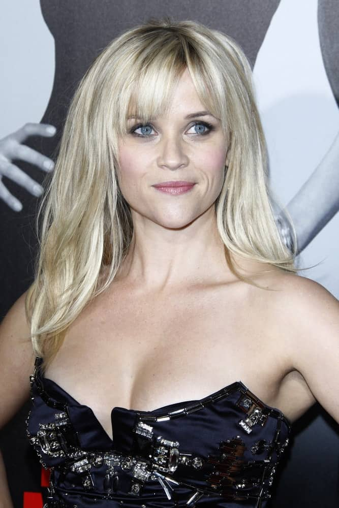 Reese Witherspoon at the premiere of Twentieth Century Fox's 'This Means War' held at Grauman's Chinese Theater on February 8, 2012 in Los Angeles, California. She came wearing a stunning strapless dress that went quite well with her tousled and loose blond hairstyle with bangs.