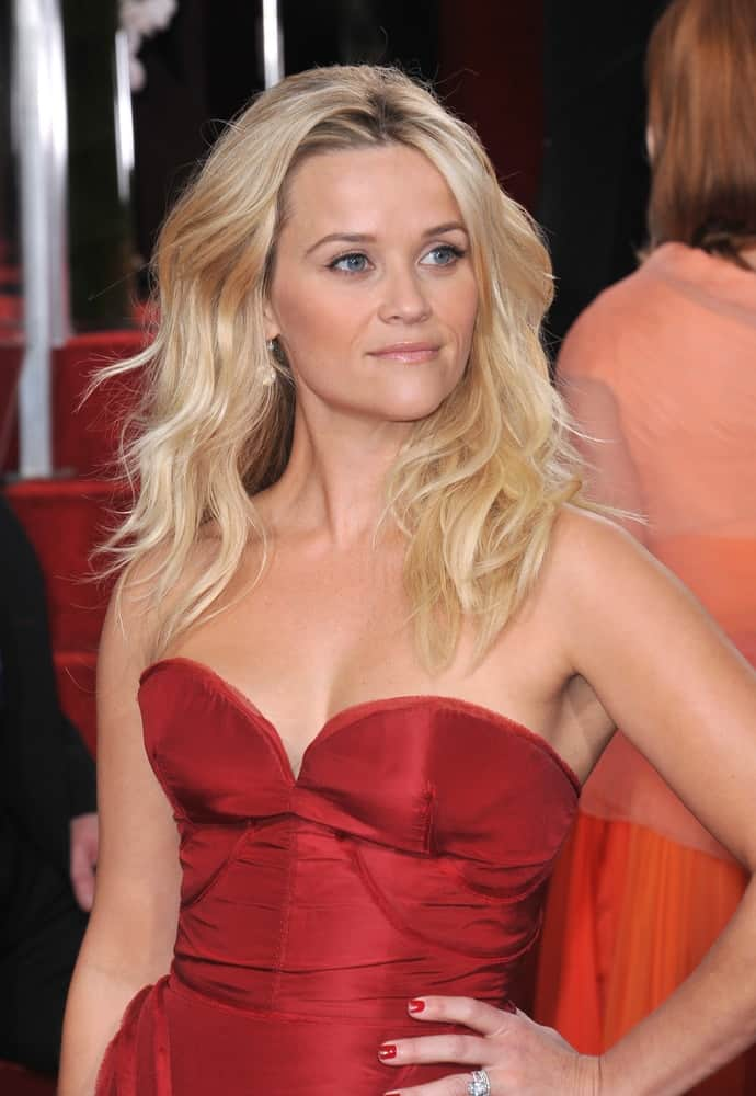 Reese Witherspoon attended the 69th Golden Globe Awards at the Beverly Hilton Hotel on January 15, 2012 in Beverly Hills, CA. She went for a sultry and sexy look to her red dress and tousled wavy blond hair with layers loose on her shoulders.