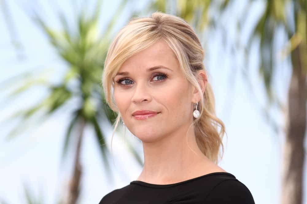 Reese Witherspoon was ever so elegant even with her simple black outfit and messy blond ponytail hairstyle that has loose blond tendrils at the 'Mud' Photocall during the 65th Annual Cannes Film Festival at Palais des Festivals on May 26, 2012 in Cannes, France.
