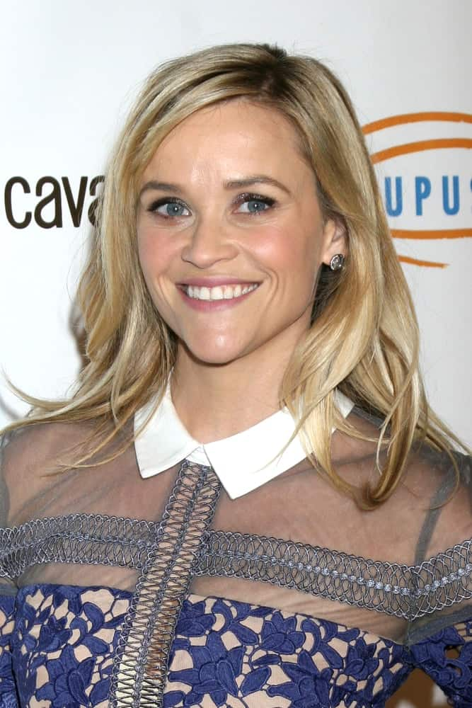 Reese Witherspoon flashed her beautiful smile that complements her floral dress and medium-length tousled and highlighted blond hairstyle at the Lupus LA Bag Ladies Luncheon at the Beverly Hilton Hotel on November 21, 2014 in Beverly Hills, CA.