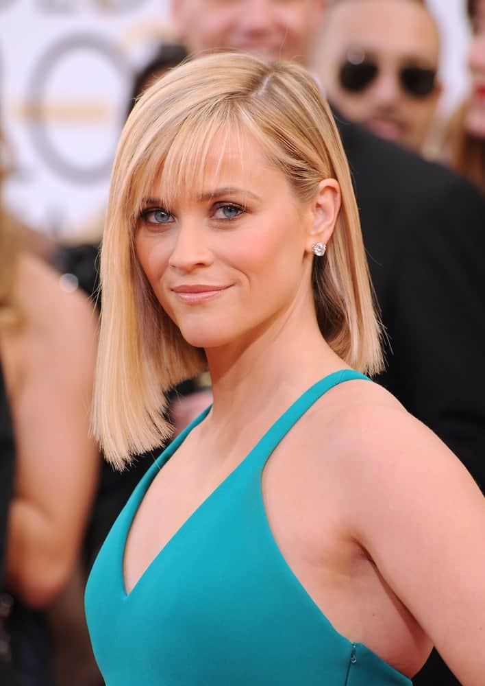 On January 12, 2014, Reese Witherspoon was at the 71st Annual Golden Globe Awards at the Beverly Hilton Hotel. She wore a sexy green dress that she paired quite well with her short asymmetric blond bob hairstyle with wispy bangs.