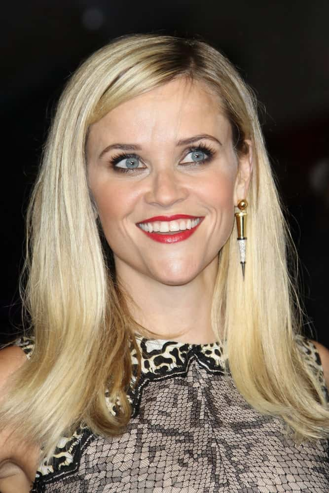 Reese Witherspoon attended the screening of 'Wild' during the 58th BFI London Film Festival at Odeon Leicester Square on October 13, 2014 in London, England. She wore a snakeskin dress to pair with her medium-length highlighted blond hairstyle loose on her shoulders.