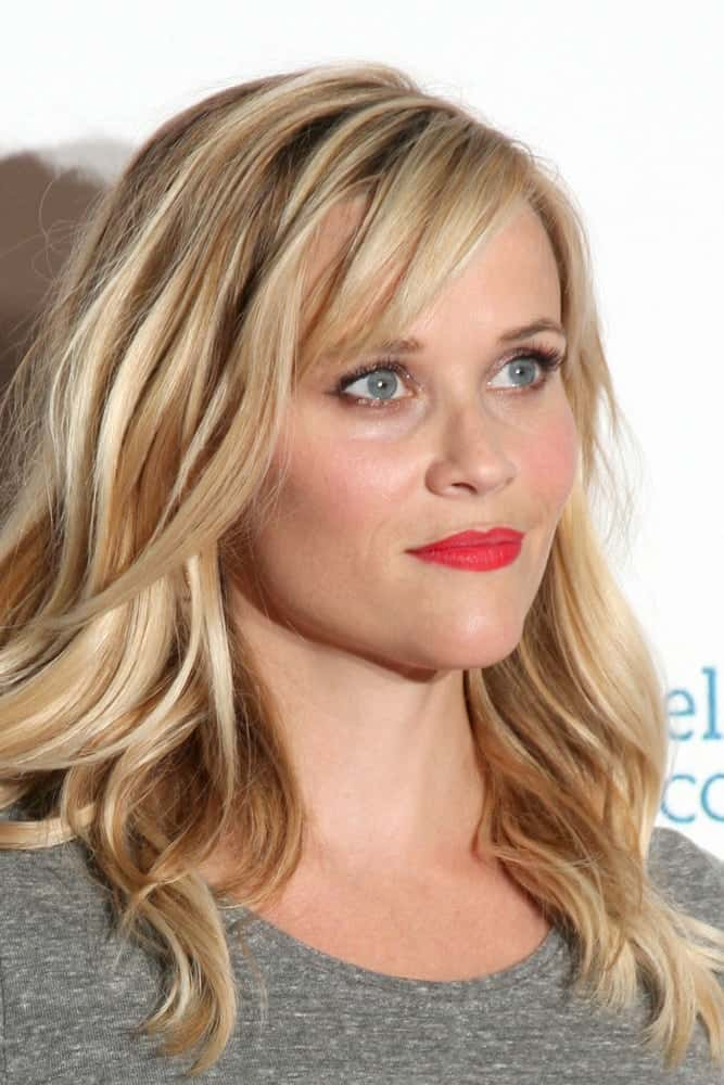Reese Witherspoon's gorgeous tousled highlighted blond locks had subtle waves to it that went quite well with her simple casual outfit at the Stand Up 2 Cancer Telecast Arrivals at Dolby Theater on September 5, 2014 in Los Angeles, CA.