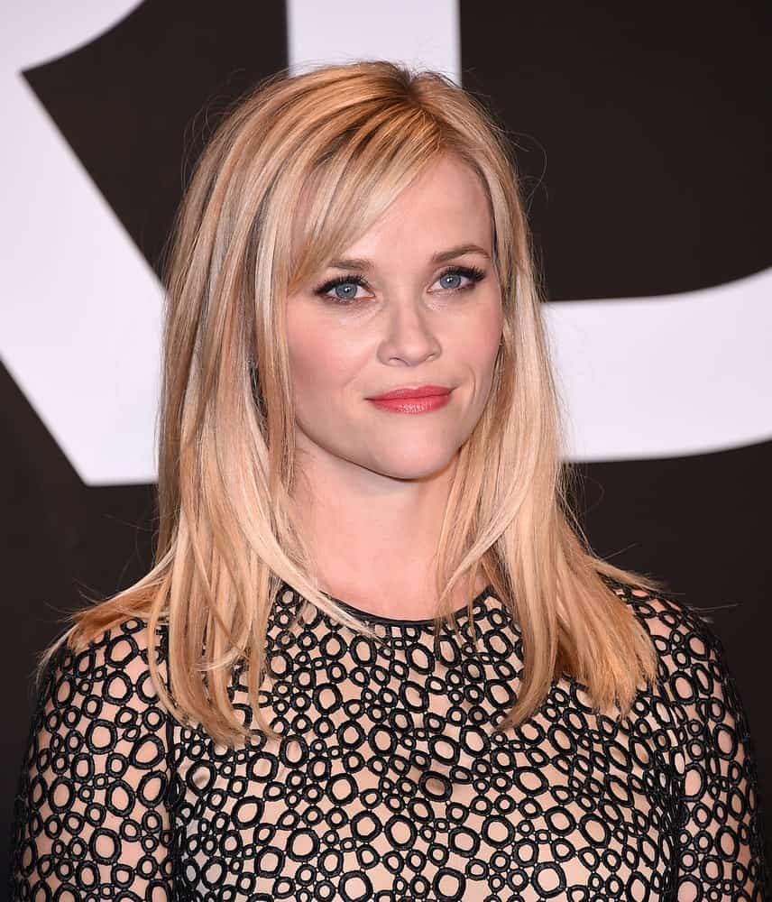 Reese Witherspoon was at the Tom Ford Autumn/Winter 2015 Womenswear Collection Presentation on February 20, 2015 in Hollywood, CA. She wore a fashionable and stylish dress that went quite well with her loose and layered sandy blond hairstyle with side-swept bangs.