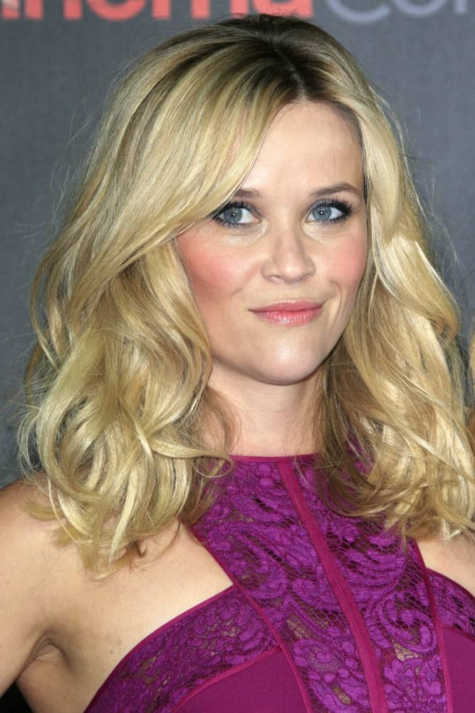 Reese Witherspoon attended the Warner Brothers 2015 Presentation at Cinemacon at the Caesars Palace on April 21, 2015 in Las Vegas CA. She wore a stunning purple dress with her tousled and wavy shoulder-length blond hairstyle with layers.