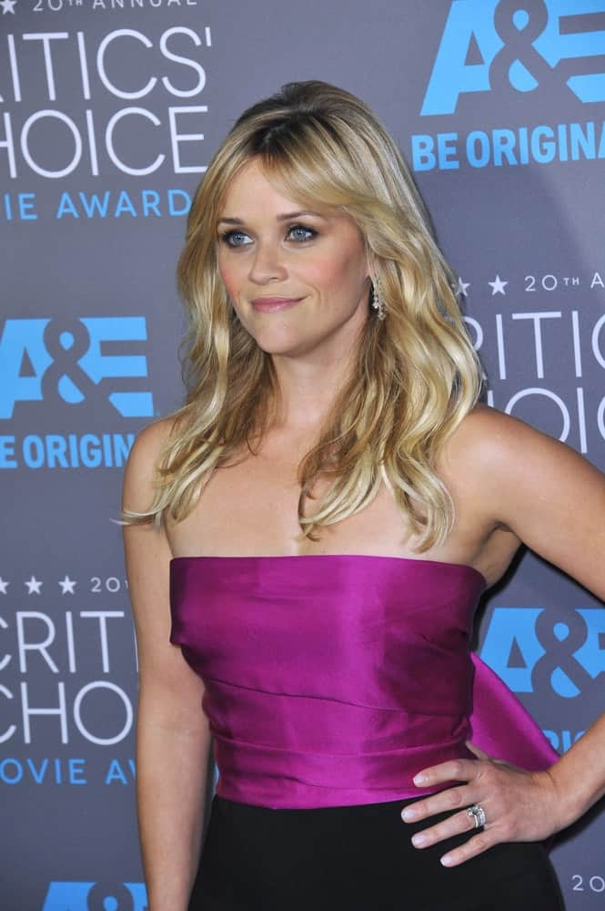 On January 15, 2015, Reese Witherspoon's lovely purple outfit paired quite nicely with her shoulder-length tousled and wavy blond hairstyle that has highlights and layers at the 20th Annual Critics' Choice Movie Awards at the Hollywood Palladium.