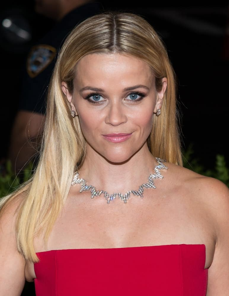 On May 04, 2015, Reese Witherspoon attended the 'China: Through The Looking Glass' Costume Institute Gala, held at the Metropolitan Museum of Art in New York City, New York. She wore a simple red strapless dress to go with her medium-length straight blond hairstyle.
