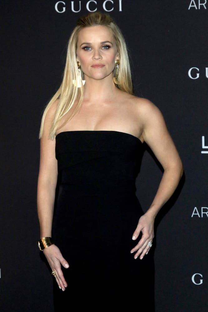 Reese Witherspoon was quite lovely in her black dress and long straight half up blond hairstyle with highlights at the LACMA Art + Film Gala at the LACMA on November 7, 2015 in Los Angeles, CA.