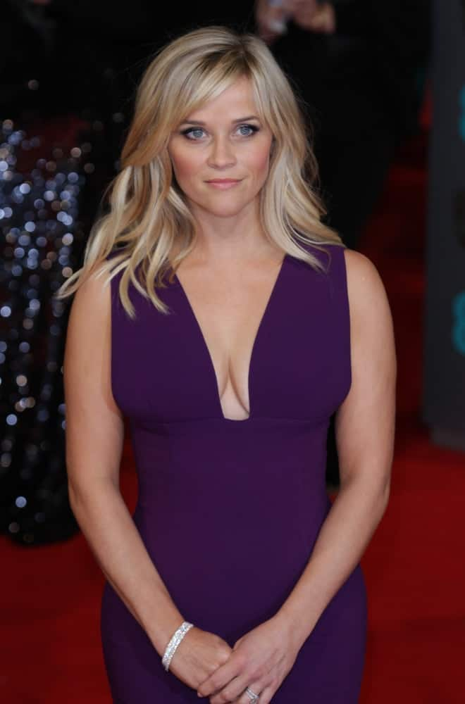 On February 8, 2015, Reese Witherspoon wore a stunning purple dress that she paired with her medium-length tousled and layered hairstyle when she attended the EE British Academy Film Awards at The Royal Opera House in London.