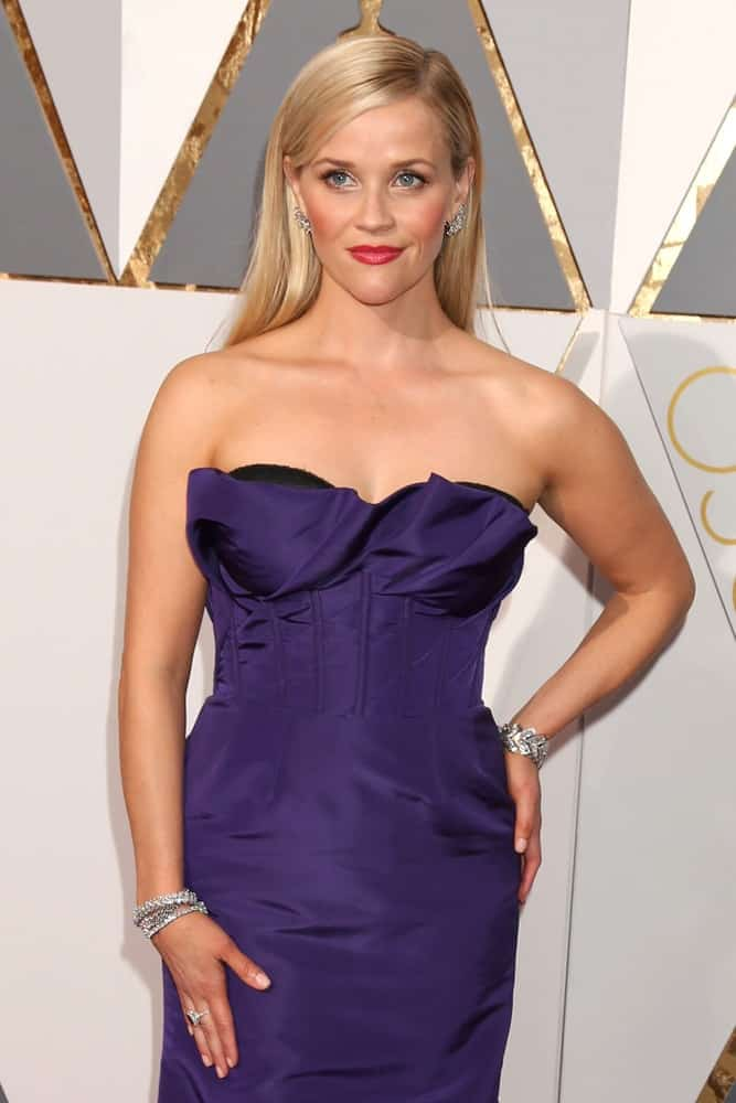 Reese Witherspoon was ever so elegant in her strapless purple dress and straight side-parted blond hairstyle loose on her back at the 88th Annual Academy Awards - Arrivals at the Dolby Theater on February 28, 2016 in Los Angeles, CA.