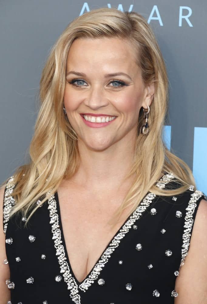 Reese Witherspoon went with a simple look to her loose and side-swept blond layered hairstyle to pair with her black bejeweled dress at the 23rd Annual Critics' Choice Awards held at the Barker Hangar in Santa Monica, USA on January 11, 2018.