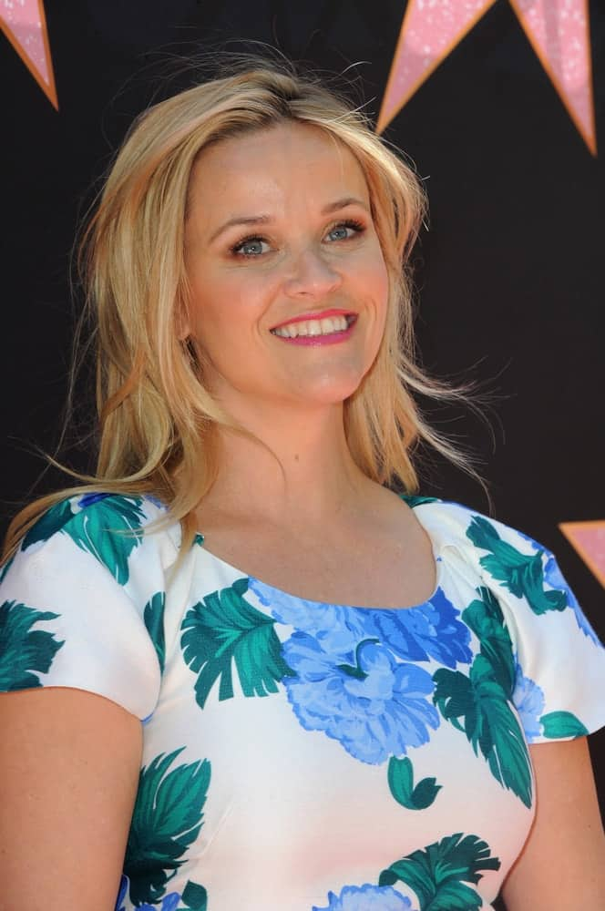 Reese Witherspoon was at the Eva Longoria's Hollywood Star Ceremony Post-Luncheon held in Beverly Hills, USA on April 16, 2018. She wore a lovely floral white dress with her tousled, layered and highlighted medium-length blond hairstyle.
