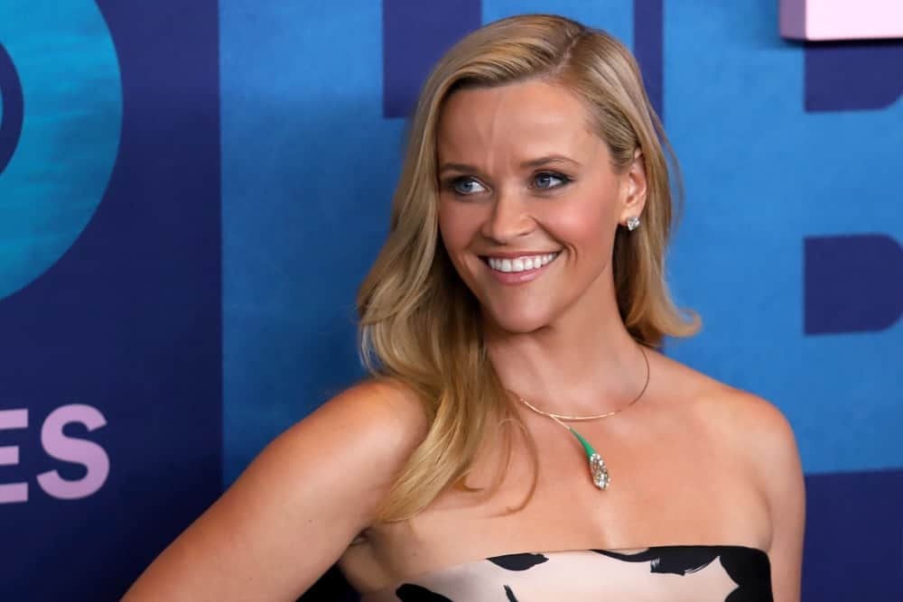 Reese Witherspoon paired her strapless dress with a side-swept layered blond hairstyle on her shoulder when she attended the season 2 premiere of