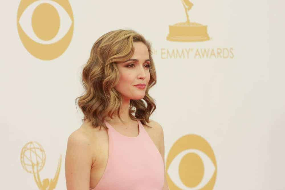 Rose Byrne was at the 65th Primetime Emmy Awards at the Nokia Theatre, LA Live on September 22, 2013, Los Angeles, CA. She was charming in a pink dress that she paired with a sandy blond bob hairstyle with waves, and highlights.