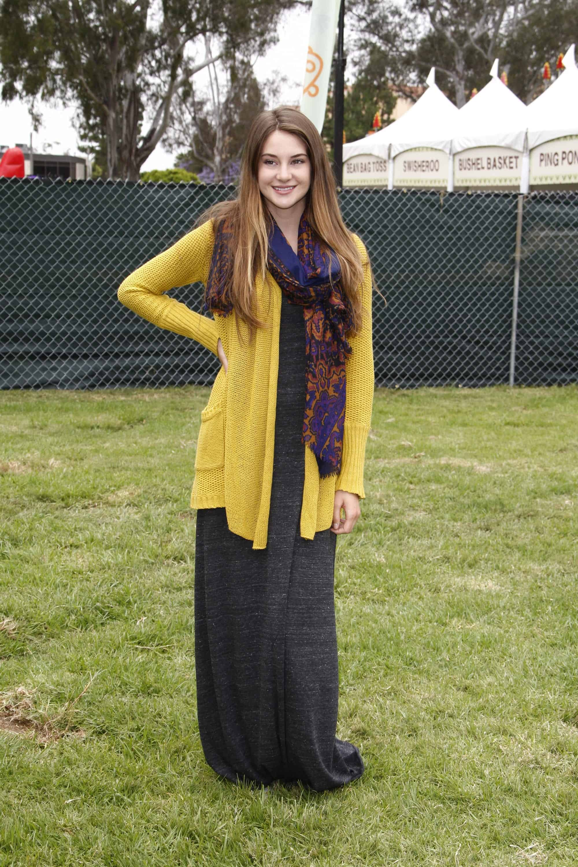 Shailene Woodley was at the 22nd Annual 'Time for Heroes' Celebrity Picnic at Wadsworth Theater on June 12, 2011 in Westwood, CA. She wore a yellow cardigan and a colorful scarf with her long and loose tousled brunette hairstyle that has highlights.