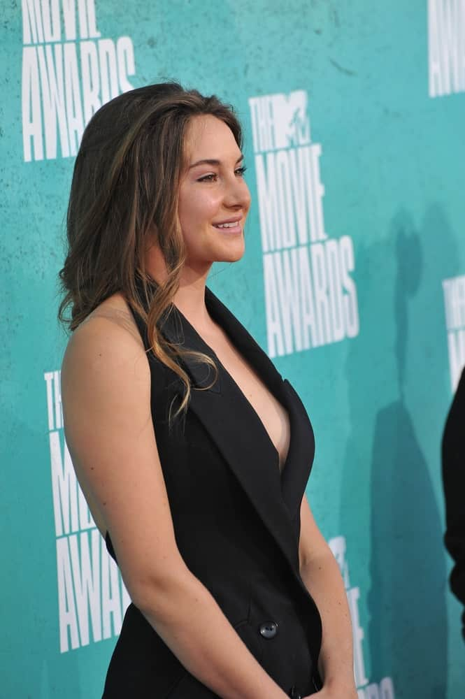 Shailene Woodley was at the 2012 MTV Movie Awards at Universal Studios, Hollywood. June 4, 2012 Los Angeles, CA. She wore a black fashionable outfit with her long and loose tousled hairstyle with curls and highlights.