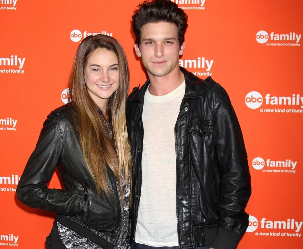 Shailene Woodley and Daren Kagasoff were at the ABC Family West Coast Upfronts at The Sayers Club on May 1, 2012 in Los Angeles, CA. Woodley wore a black leather jacket to pair with her long, layered, loose and highlighted brunette hairstyle with a slight tousle.