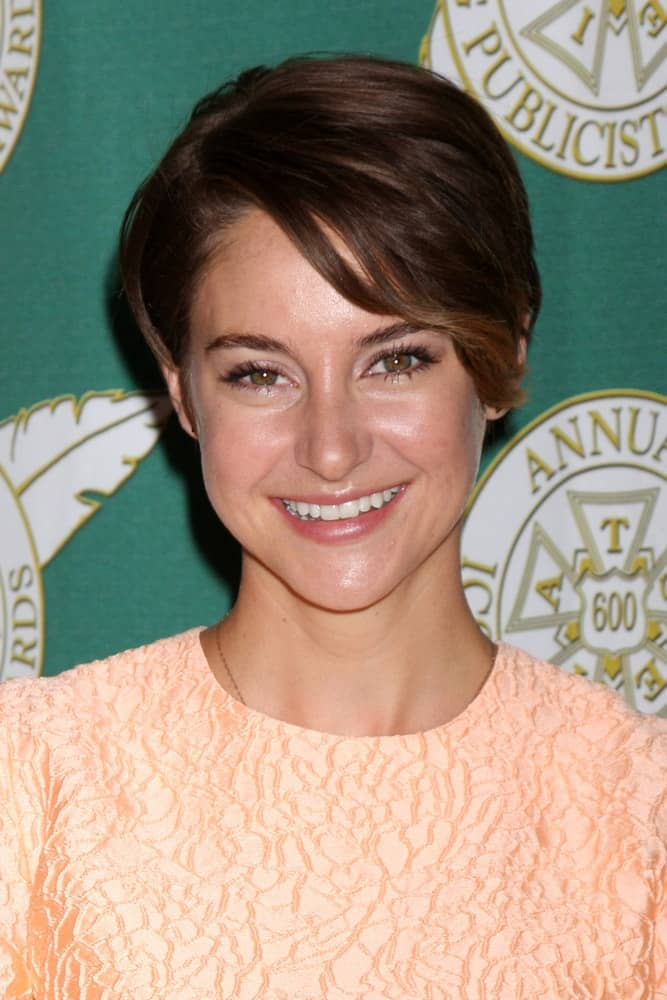 Shailene Woodley was at the 2014 Publicist Luncheon at Beverly Wilshire Hotel on February 28, 2014 in Beverly Hills, CA. She was charming in a peach dress to pair with her brunetter pixie hairstyle with side-swept bangs.