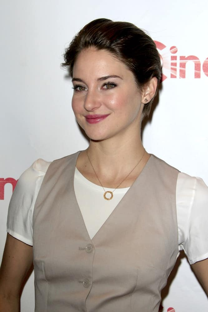 Shailene Woodley attended the 20th Century Fox CinemaCon 2014 Photo Call at Caesars Palace on March 27, 2014 in Las Vegas, NV. She wore a vest over her white blouse and paired it with a slicked-back raven pixie hairstyle.
