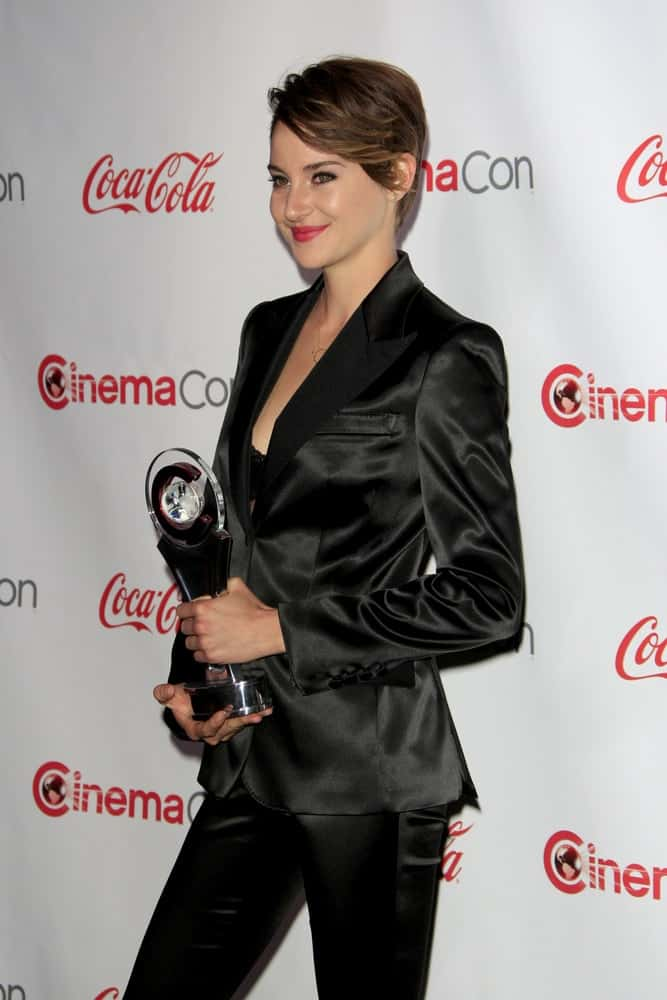 Shailene Woodley was at the CinemaCon 2014 Awards Gala at Caesars Palace on March 27, 2014 in Las Vegas, NV. She wore an all-black outfit with her brunette pixie hairstyle that has long side-swept bangs.