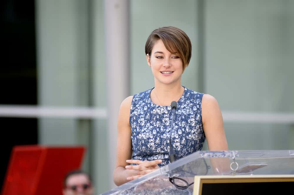 Shailene Woodley spoke at Kate Winslet's star receiving ceremony at Hollywood Blvd on March 17, 2014 in Los Angeles, CA. She wore a floral dress with her side-swept brunette pixie hairstyle.