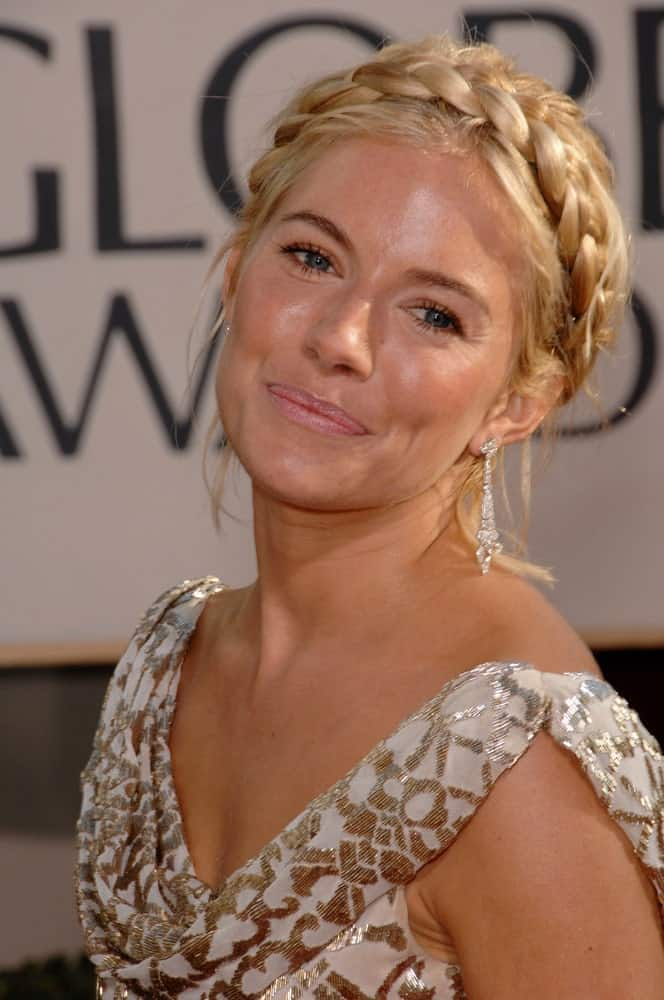 Sienna Miller looks gorgeous in a crown braided hairstyle with loose strands that she wore during the 64th Annual Golden Globe Awards on January 15, 2007.