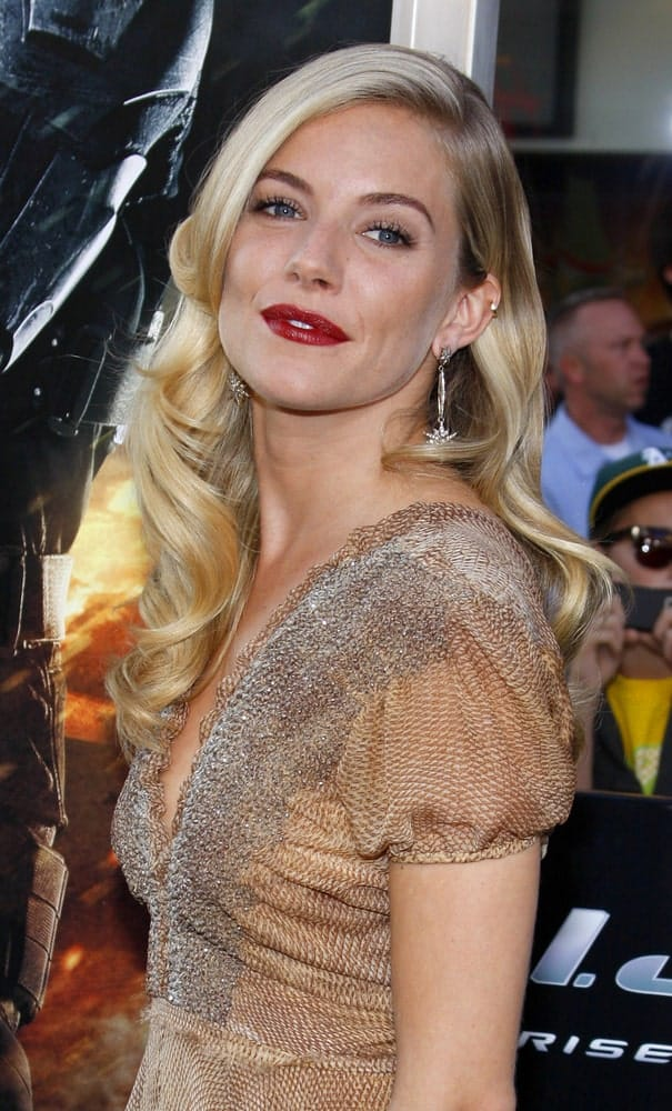 Sienna Miller overflowed with posh and class in an embroidered dress along with highlighted side-swept curls at the Los Angeles special screening of 'G.I. Joe: The Rise Of The Cobra' held on August 6, 2009.