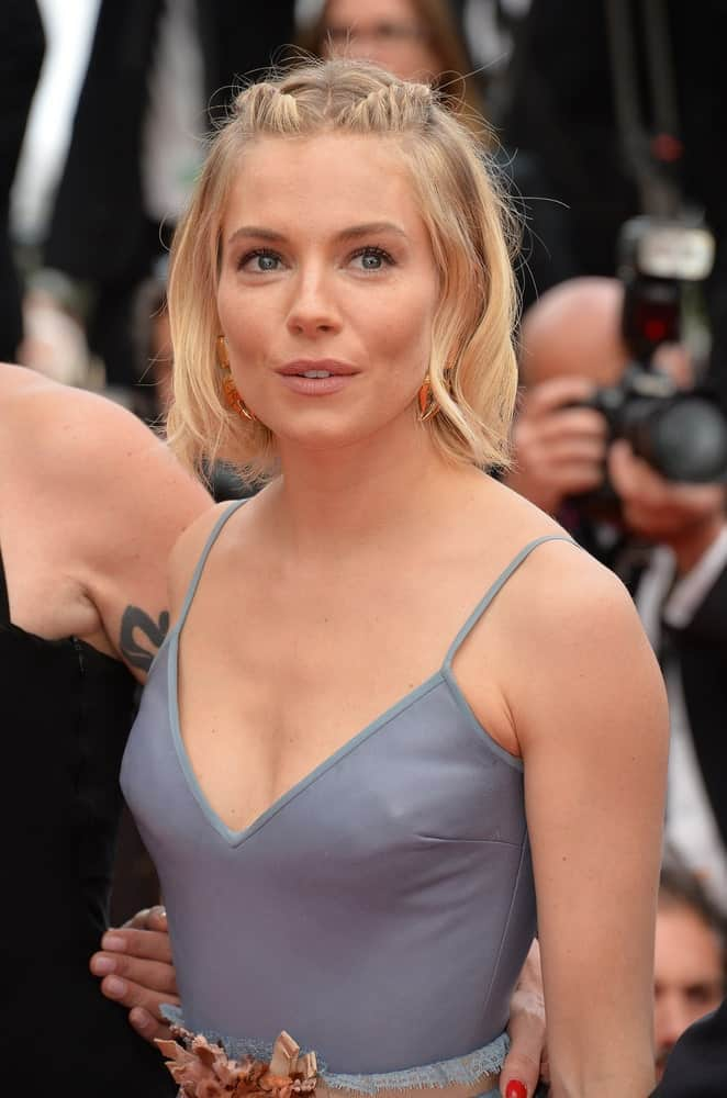 Sienna Miller was polished in a cerulean blue gown and her oval face is flattered by her wavy bob hairstyle with a few pieces center-parted and twisted at the top as she attends the closing gala for the 68th Festival de Cannes on May 24, 2015.