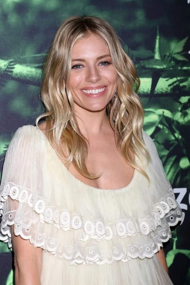 Sienna Miller was the ultimate boho in her lemon frill dress and beachy loose waves as she attends the