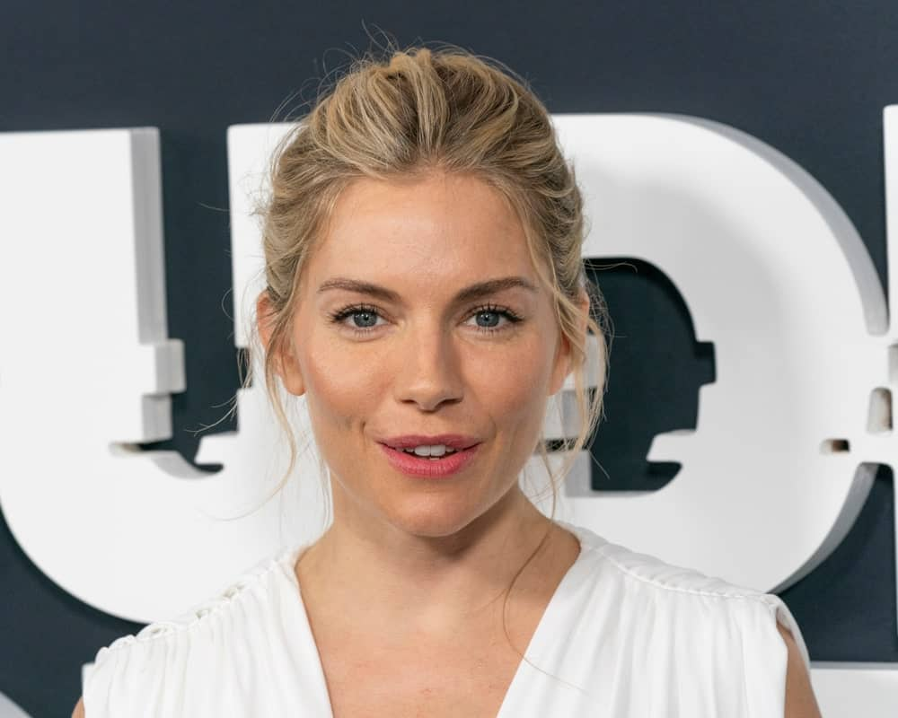 Sienna Miller is a goddess in this brushed back upstyle with loose strands at the Showtime network premiere of The Loudest Voice on June 24, 2019. She completed the look with a white dress by Oscar de la Renta.