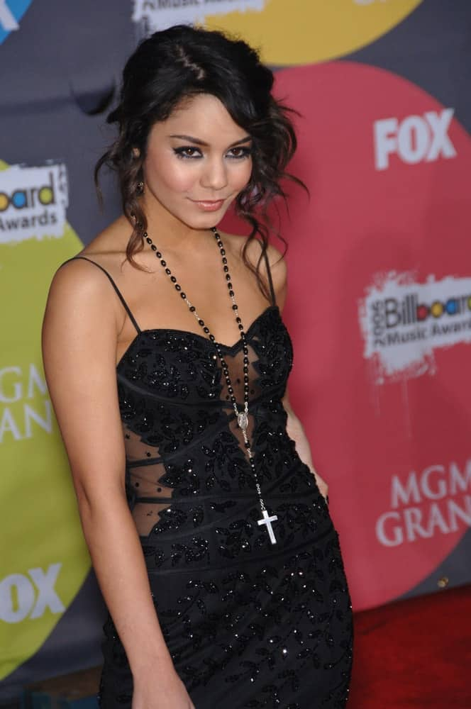 Vanessa Hudgens wore an elegant black sequined dress to pair with her messy upstyle that has loose surly black tendrils at the 2006 Billboard Music Awards at the MGM Grand in Las Vegas on December 4, 2006.