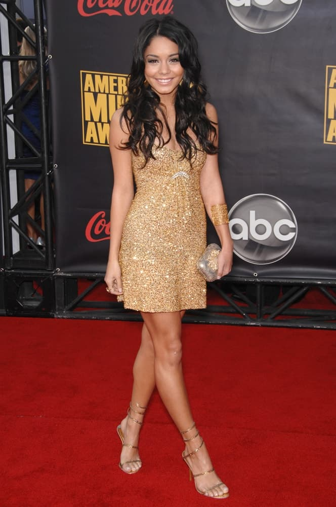 Vanessa Hudgens went with a carefree tousled and loose curly raven hairstyle to match with her gorgeous golden dress at the 2007 American Music Awards at the Nokia Theatre, Los Angeles on November 18, 2007 in Los Angeles, CA.