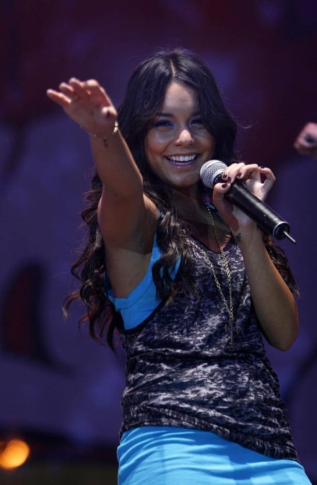 Vanessa Hudgens performed on stage for her Concert at the Utah State Fair in Salt Lake City, UT on September 05, 2008. She was seen wearing a casual outfit that she paired with her long and loose curly raven hairstyle.