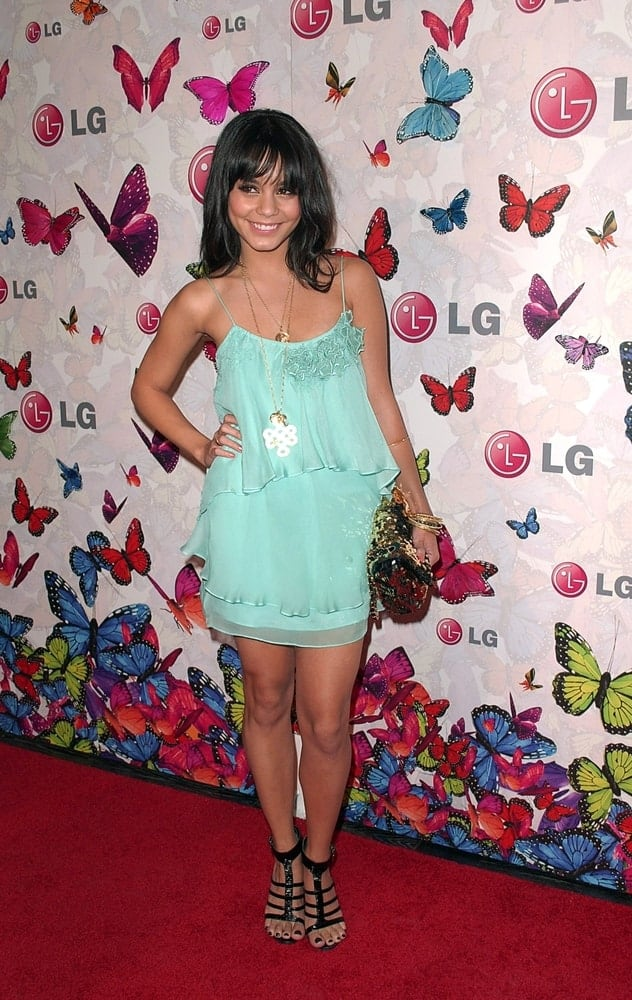 Vanessa Hudgens was at the LG Rumorous Night Rumor2 Mobile Phone Launch Party held at the Andaz Hotel in Los Angeles, CA on April 28, 2009. She was lovely in her short blue green dress and straight shoulder-length hair with wispy bangs and flippy tips.