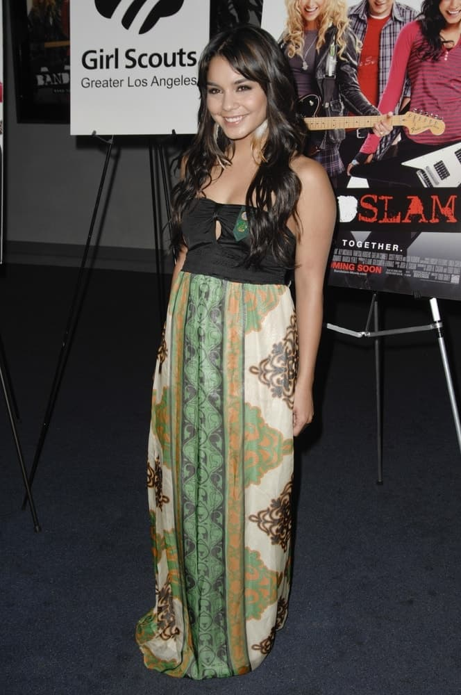 Vanessa Hudgens was at the Girl Scout Advance Screening of BANDSLAM held at the Harmony Gold Theater in Los Angeles, CA on August 7, 2009. She wore a gorgeous colorful long dress that she paired with her loose and tousled wavy layered hairstyle with highlights.