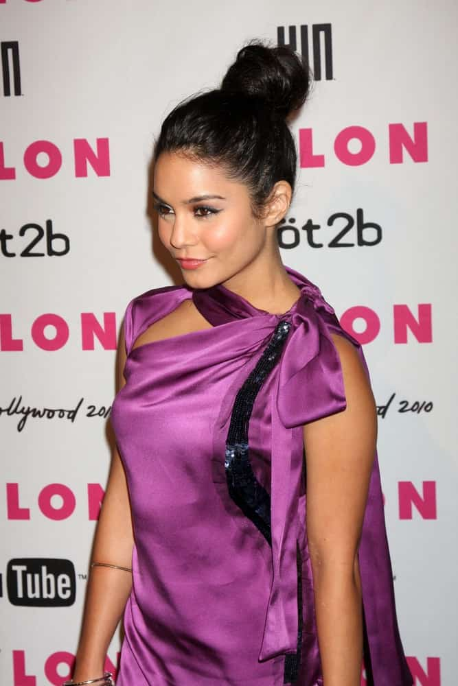Vanessa Hudgens paired her lovely purple silk dress with a slick high bun hairstyle and simple make-up at the Nylon Magazine Young Hollywood Party 2010 at the Hollywood Roosevelt Hotel in Los Angeles, California on May 12, 2010.