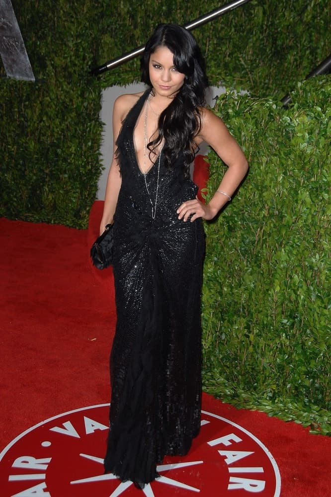 Vanessa Hudgens wowed everyone with her stunning black sequined dress that she paired with her long side-swept raven hairstyle with layers and curls at the Vanity Fair Oscar Party held at the Sunset Tower Hotel in Los Angeles, CA on March 7, 2010.