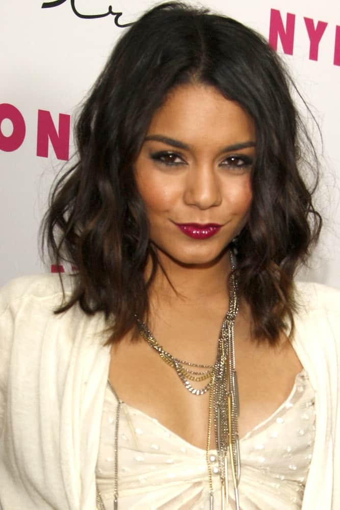 Vanessa Hudgens attended the Nylon Magazine 12th Anniversary Issue Party at Tru Hollywood on March 24, 2011 in Los Angeles, CA. She wowed everyone with her all-white outfit and shoulder-length tousled wavy hairstyle with subtle highlights.