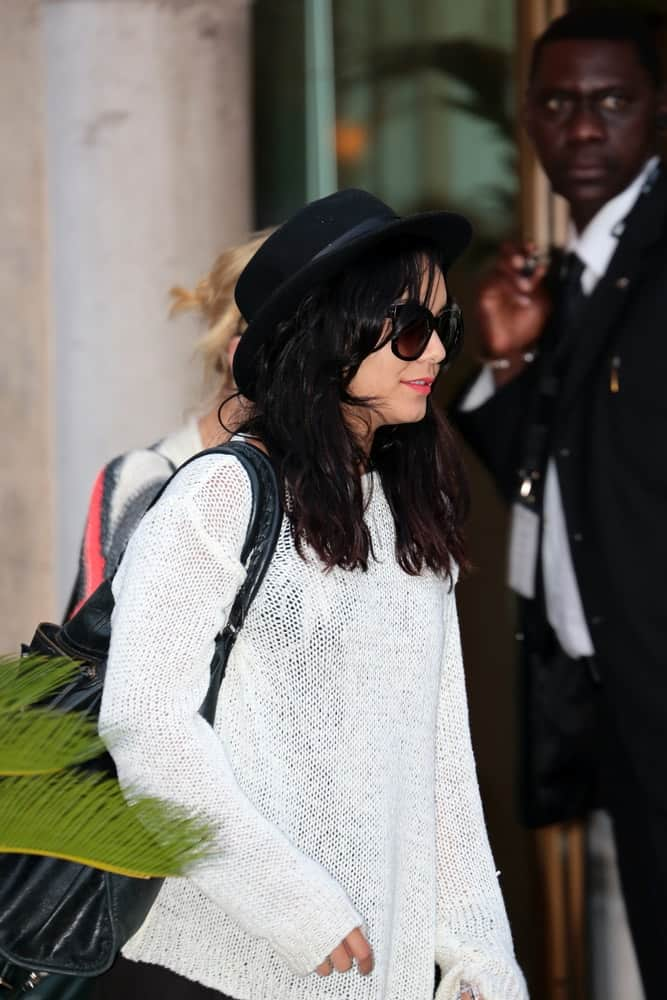 Vanessa Hudgens was at the Venice Film Festival on September 04, 2012 in Venice, Italy. She was seen arriving in casual clothes that she paired with a tousled and loose medium-length hairstyle with a shiny raven tone.