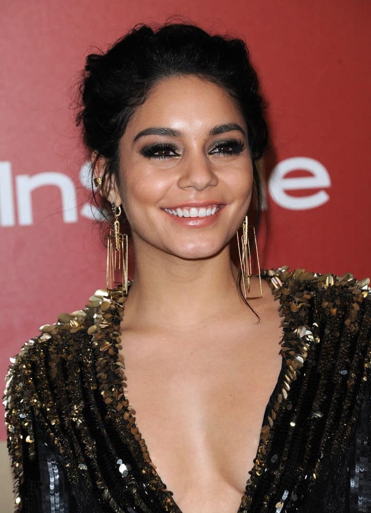 Vanessa Hudgens wore a gorgeous and stunning black sequined dress with her messy raven upstyle that has loose tenrils at the WB/In Style Golden Globe Party on January 13, 2013 in Hollywood, CA.