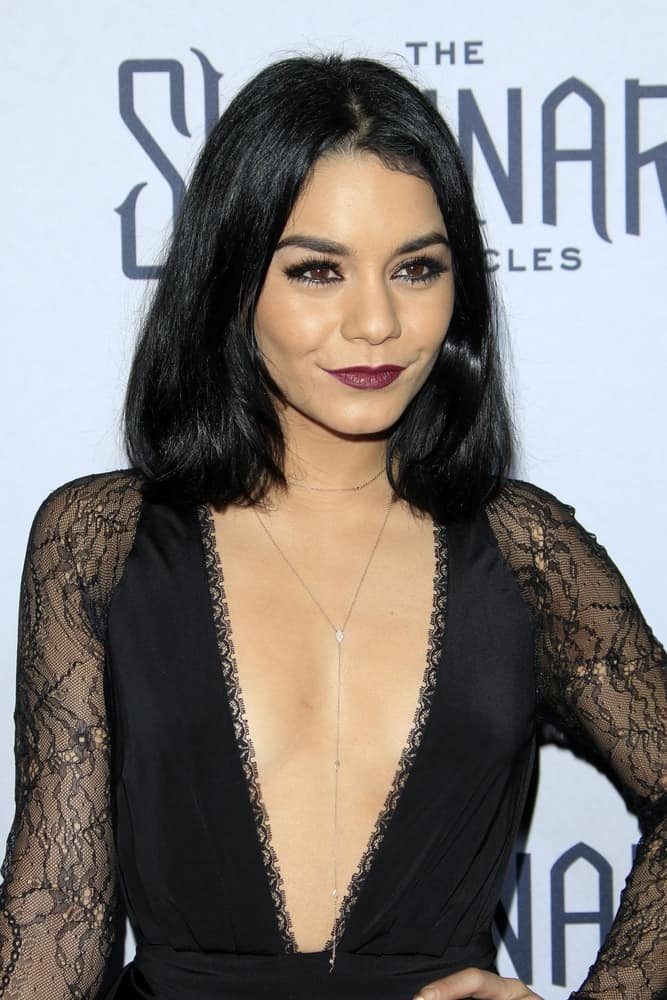 Vanessa Hudgens wore a stylish and stunning black dress to pair with her bold lips and straight shoulder-length bob hairstyle at the Shannara Chronicles premiere at the iPic Theaters on December 4, 2015 in Los Angeles, CA.