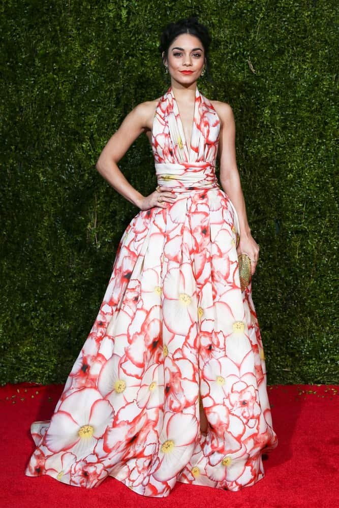 Actress Vanessa Hudgens attended the American Theatre Wing's 69th Annual Tony Awards at Radio City Music Hall on June 7, 2015 in New York City. She was quite lovely in her long floral dress that she paired with a messy upstyle incorporated with braids.