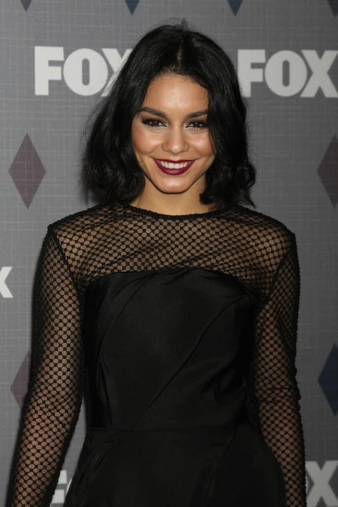 Vanessa Hudgens went for a simple look to her black dress that she paired with her simple make-up and loose shoulder-length hairstyle that has a slight tousle and waves at the tips at the FOX Winter TCA 2016 All-Star Party at the Langham Huntington Hotel on January 15, 2016 in Pasadena, CA.