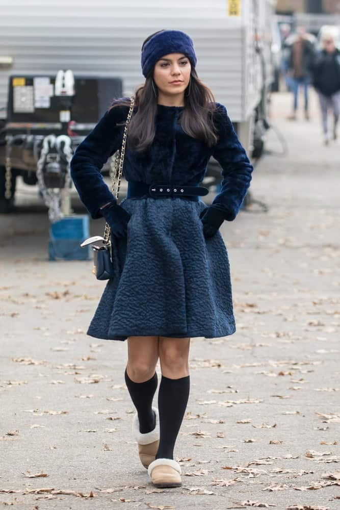 Vanessa Hudgens was seen on the film set of 'Second Act' in Central Park on December 6, 2016 in New York City. She was seen with fashionable winter clothes that goes well with her headband and long raven hairstyle with a slight tousle.