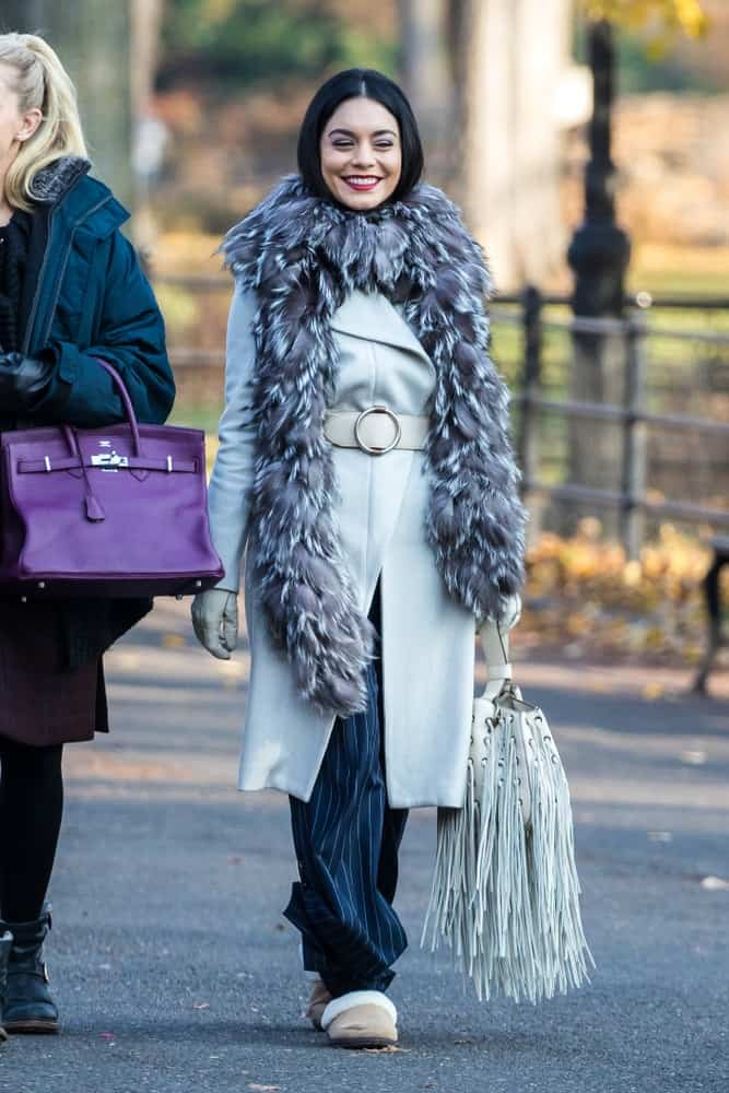 Vanessa Hudgens was seen on the film set of 'Second Act' in Central Park on December 6, 2016 in New York City. She wore layers of comfortable clothing against the cold winter to go with her long raven hair that frames her face.